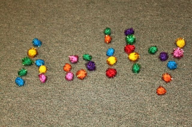 Sparkle Spelling with pom poms.  This really makes you focus!  I would write out large sight words on a laminated sheet of paper if I were using this with younger kids, because it really forces you to think about letter formation.