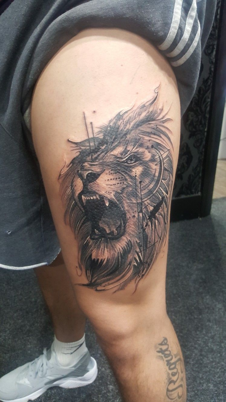 Lion abstract tattoo on thigh done at Vivid ink Mosley Birmingham #lion #tattoo #thightattoo #lionhe