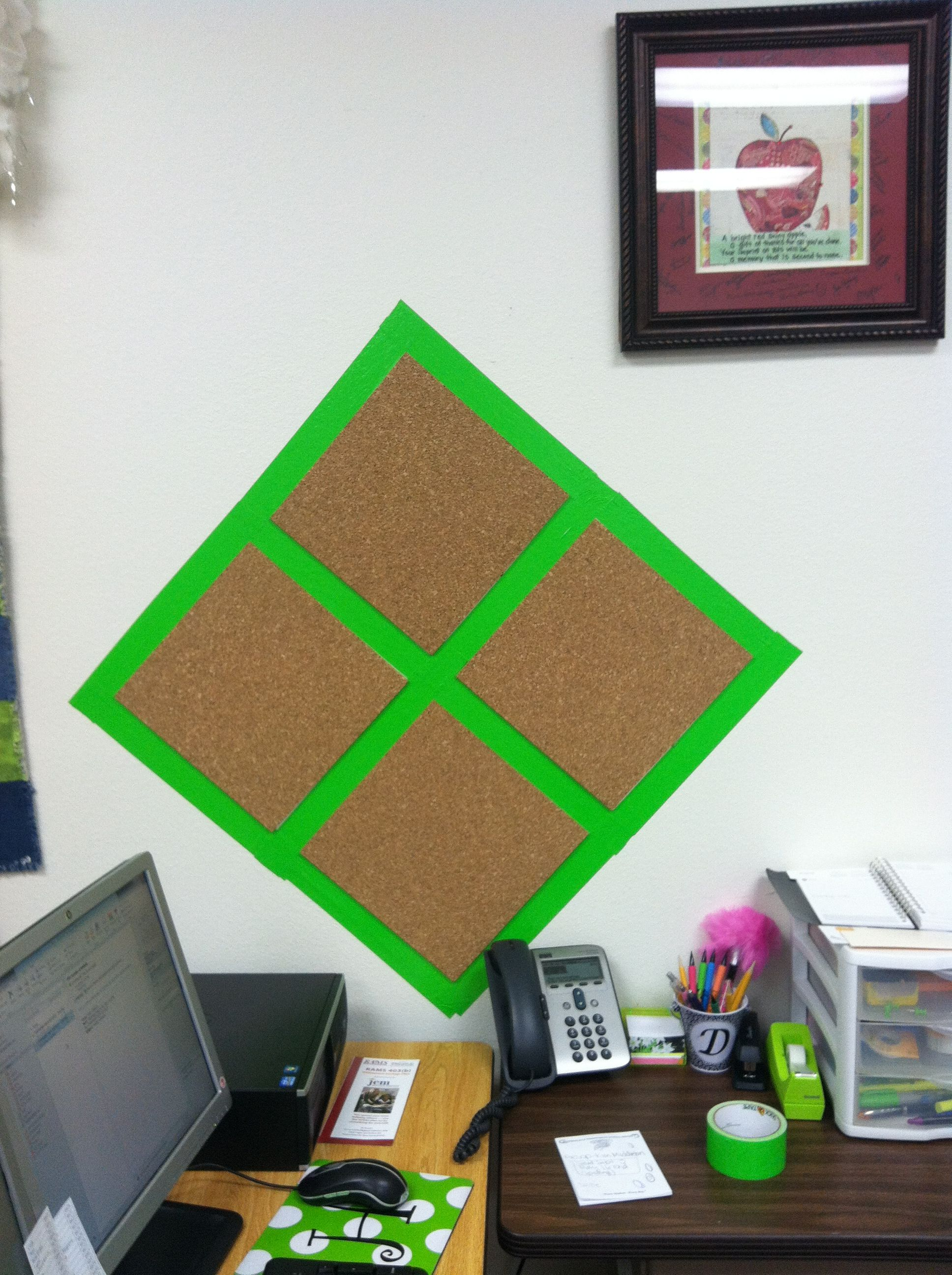 A bulletin board made with cork squares and colored duct tape