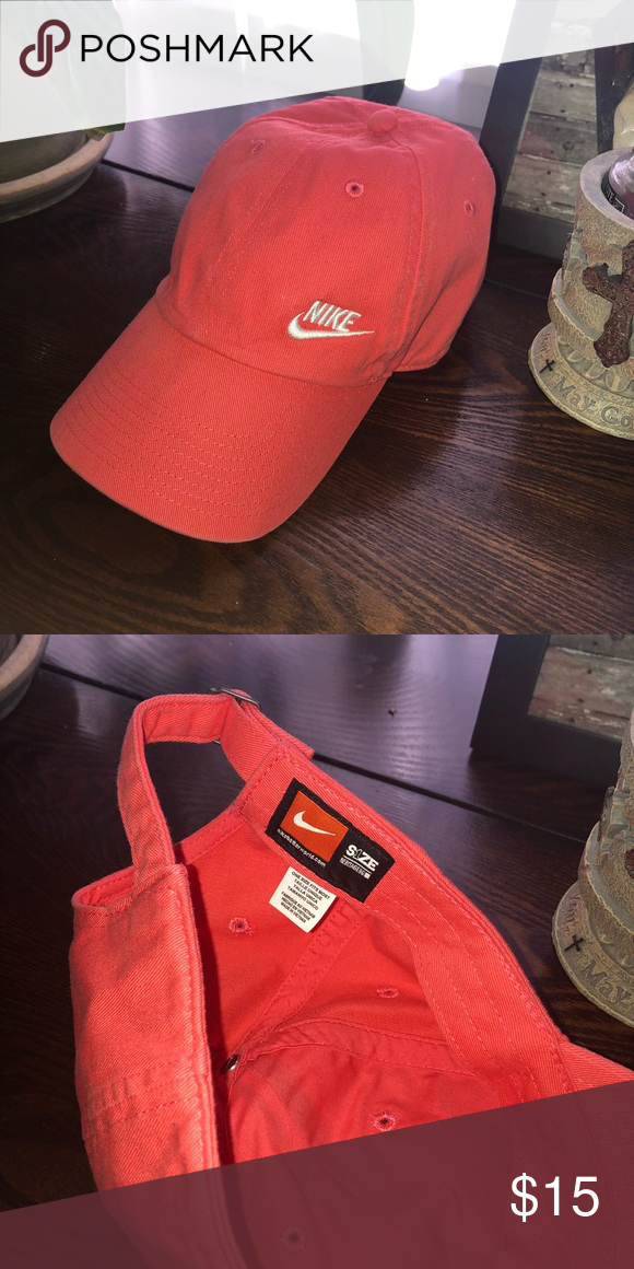 9f45bfa7754 Nike hat! Pink or salmon colored Nike hat! One size fits all and In perfect  condition only worn a few times and no flaws! Nike Accessories Hats