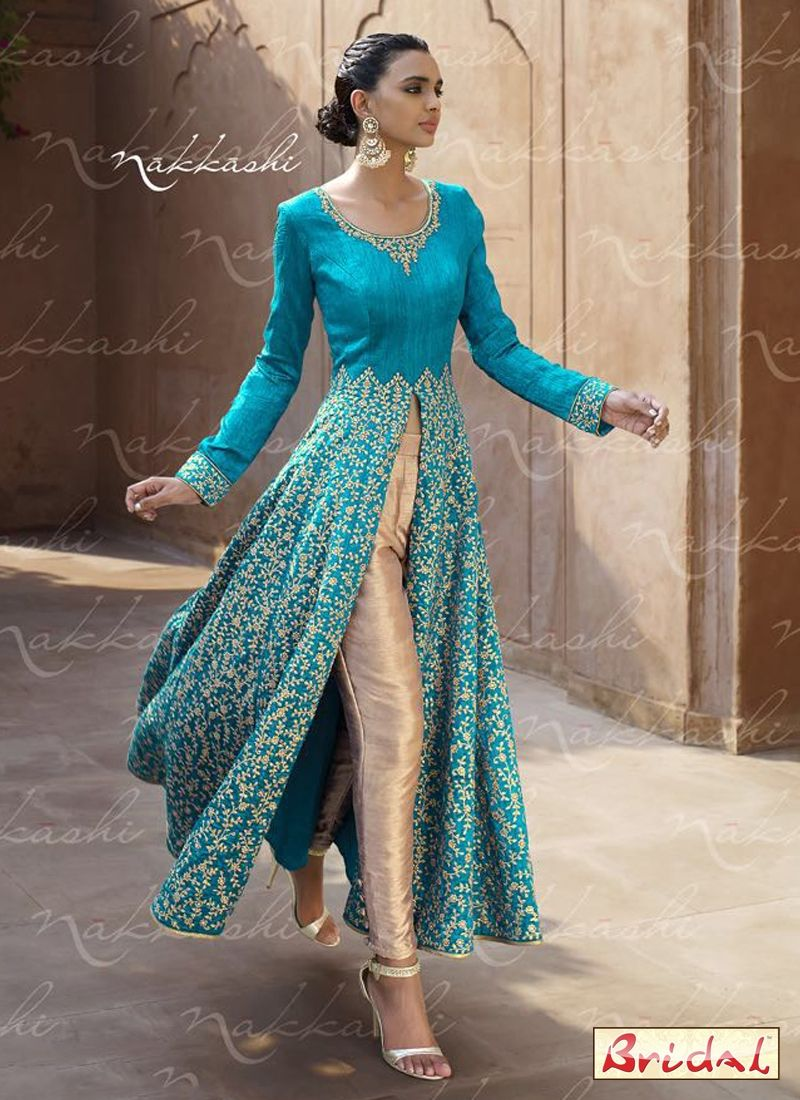 Designer Indian Bridal wear ..Nakkashi heavy embroided silk gown ...