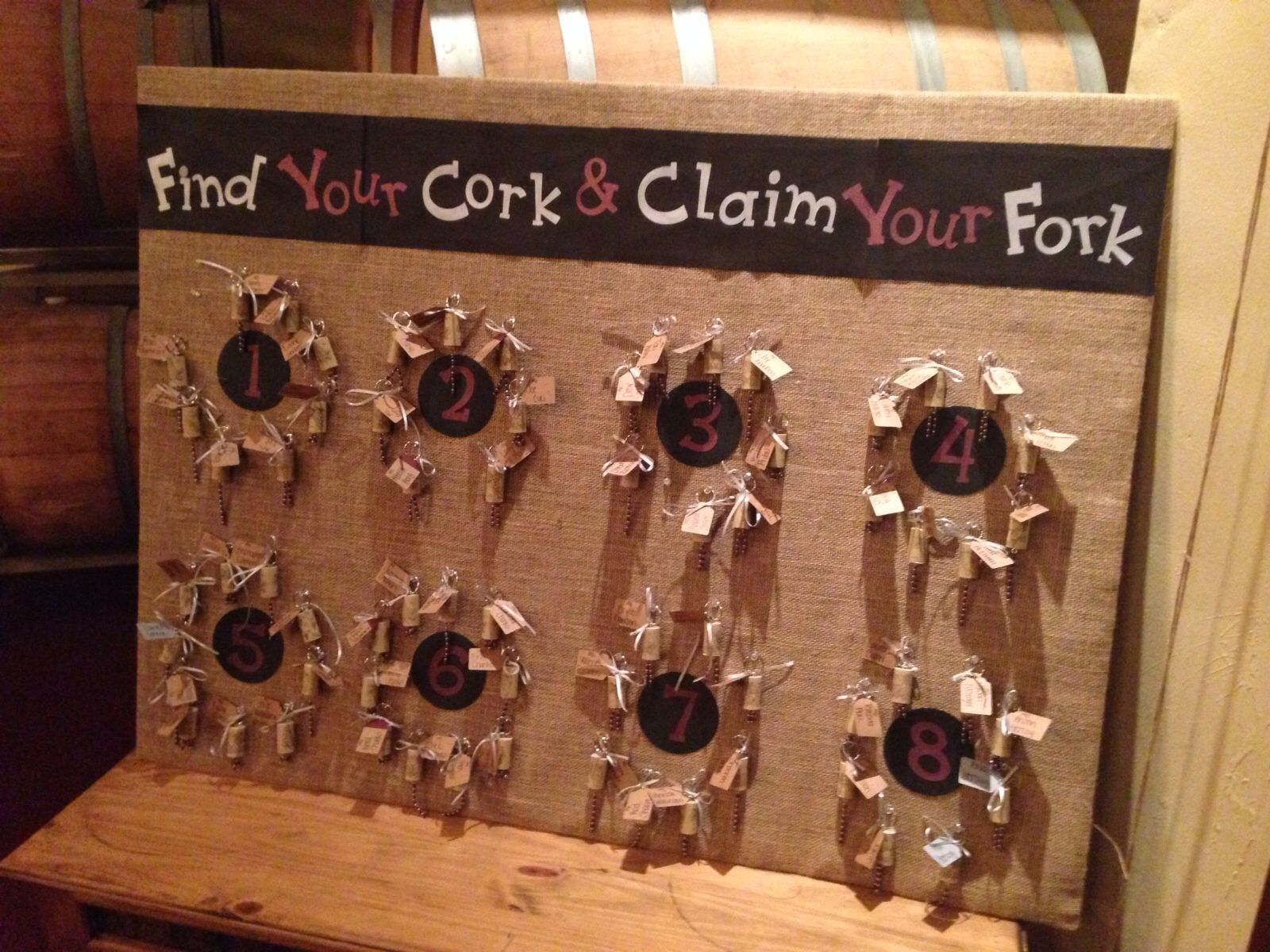 Seating chart with beaded wine cork keychains