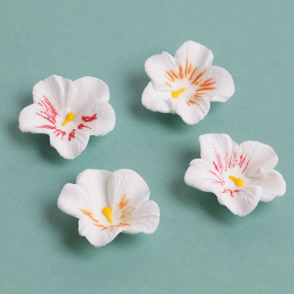 White Petite Pansies Gumpaste Sugarflower edible cake decoration perfect for adding on top of your cakes and cupcakes. | CaljavaOnline.com
