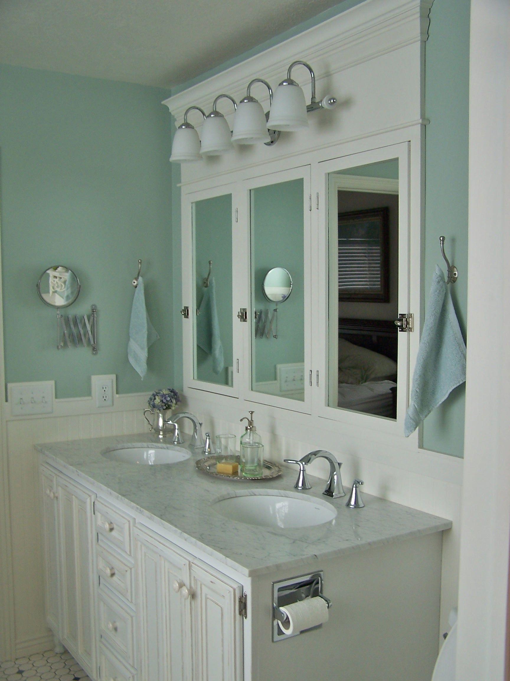 farmhouse bathroom design - light aqua blue walls and white marble