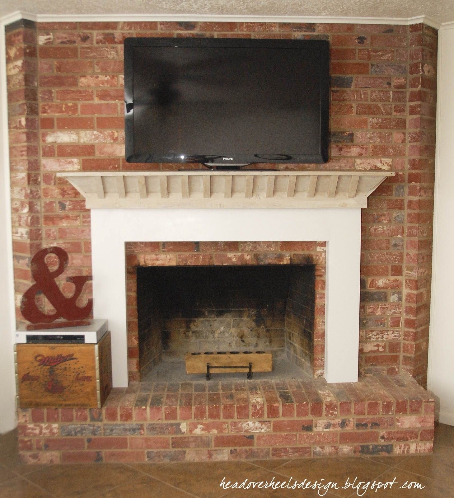 Head over heels tv on a brick fireplace a whitewashed for Tv over fireplace