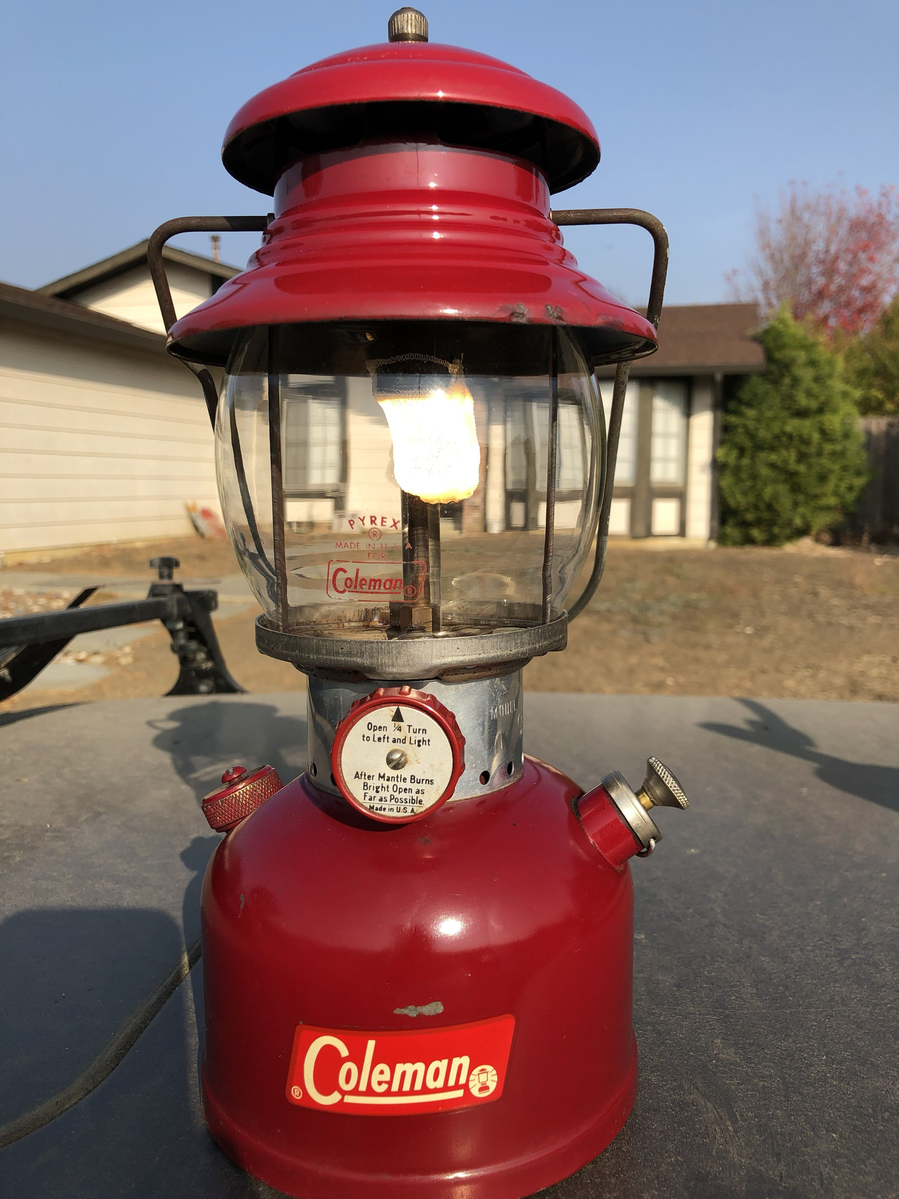 Coleman 200a White Fuel Camping Lantern  Dark red in color