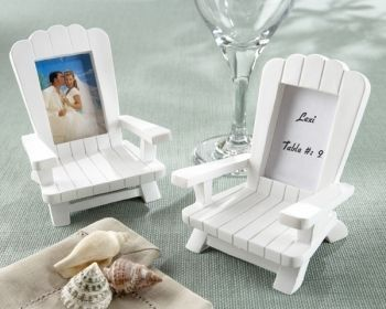 "These miniature adirondack chair frames are handcrafted, hand painted, and provide a decorative touch to beach events. The chair frames are made of poly resin and can be used later to display a photo. These chairs are white and measure 3""x 2 ¼"" with a 1 ½"" x 1 ¼"" frame for a place card or photo."