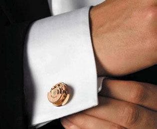 Milus cufflinks with an eye-catching detail...rotating watch movements.