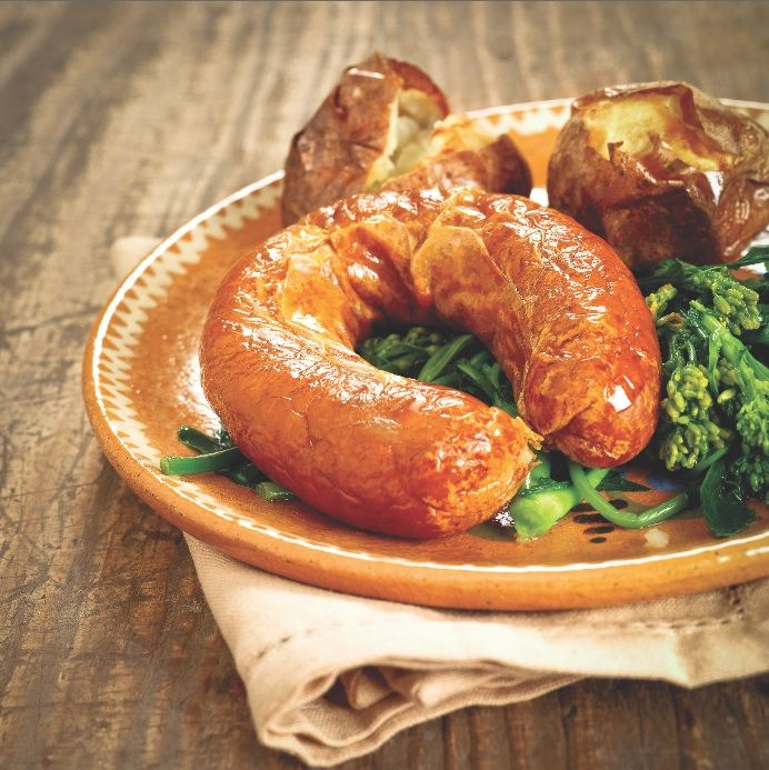 Alheira de Mirandela with baked potatoes and turnip greens or kale
