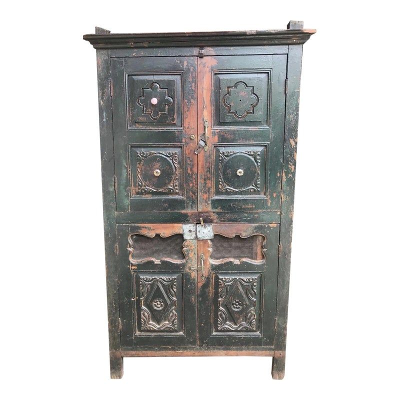 Make your home look like something out of a dream with our new armoire! With plenty of storage and a lovely developed patina, this funky Indian piece definitely has a lot of character and despite being obviously well-loved, this is another beautifully antique piece that's a perfect shelving unit for any room.  Measures 64 1/2 (H) x 34 3/4 (W) x 21 1/4 (D)