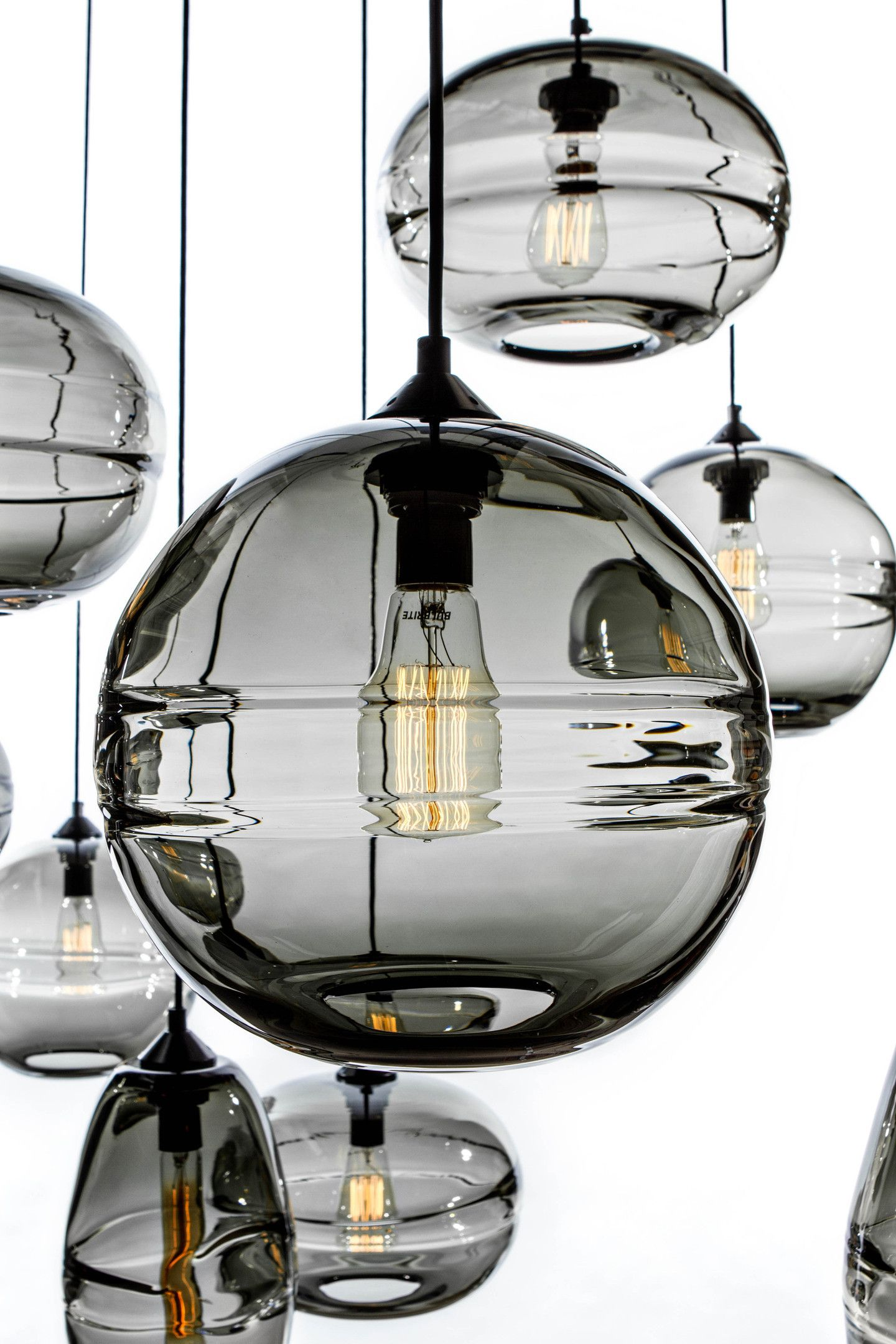 John pomp hand blown sculpted glass pendants contemporary these lights in clear glass the rim around the center creates a very beautiful light love this option or the kitchen makes the kitchen more modern aloadofball Image collections