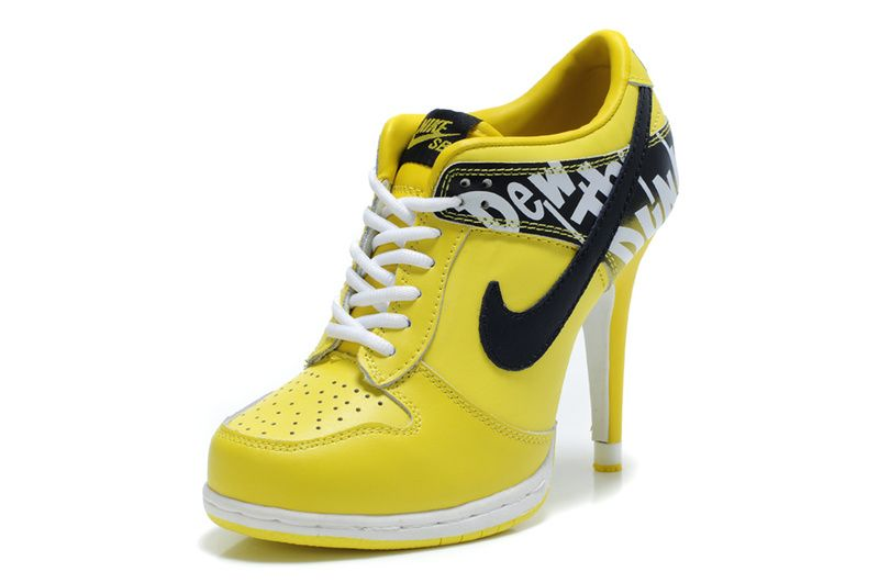 Why are high-heeled sneakers back again. Still a don't -- Nike - high-  heeled, cab-yellow sneakers.