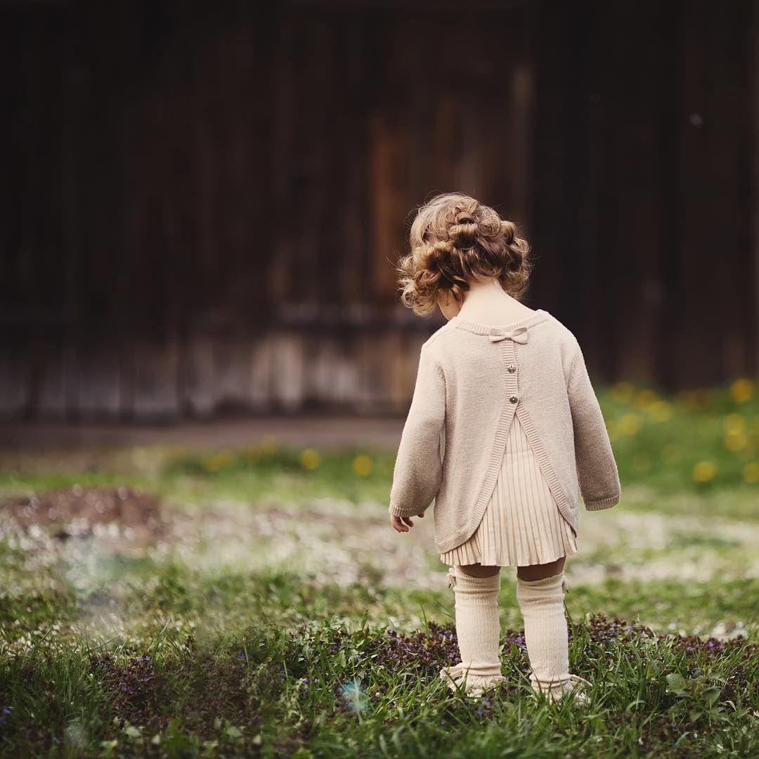 Sweet girl child in vintage retro sweater dress