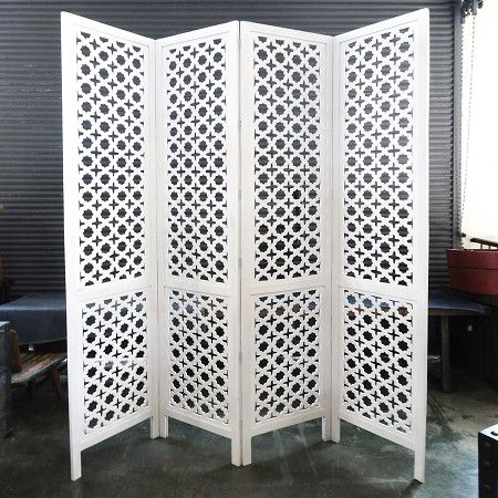 intricate sliding room divider. A beautiful and intricately carved wood Jali screen room divider at MIX  This is like the one in photo with mid century modern white upholstered