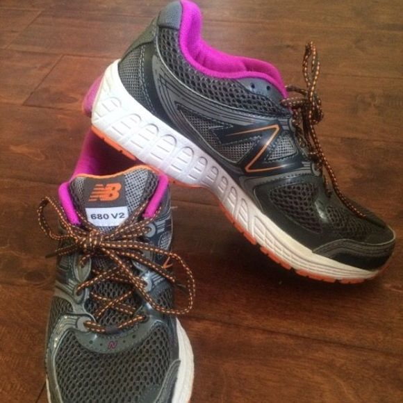 Women's New Balance 680 V2 Very gently used women's new balance running shoes. Grey pink and orange. Size 7. Hardly worn as seen in pics. New Balance Shoes Athletic Shoes