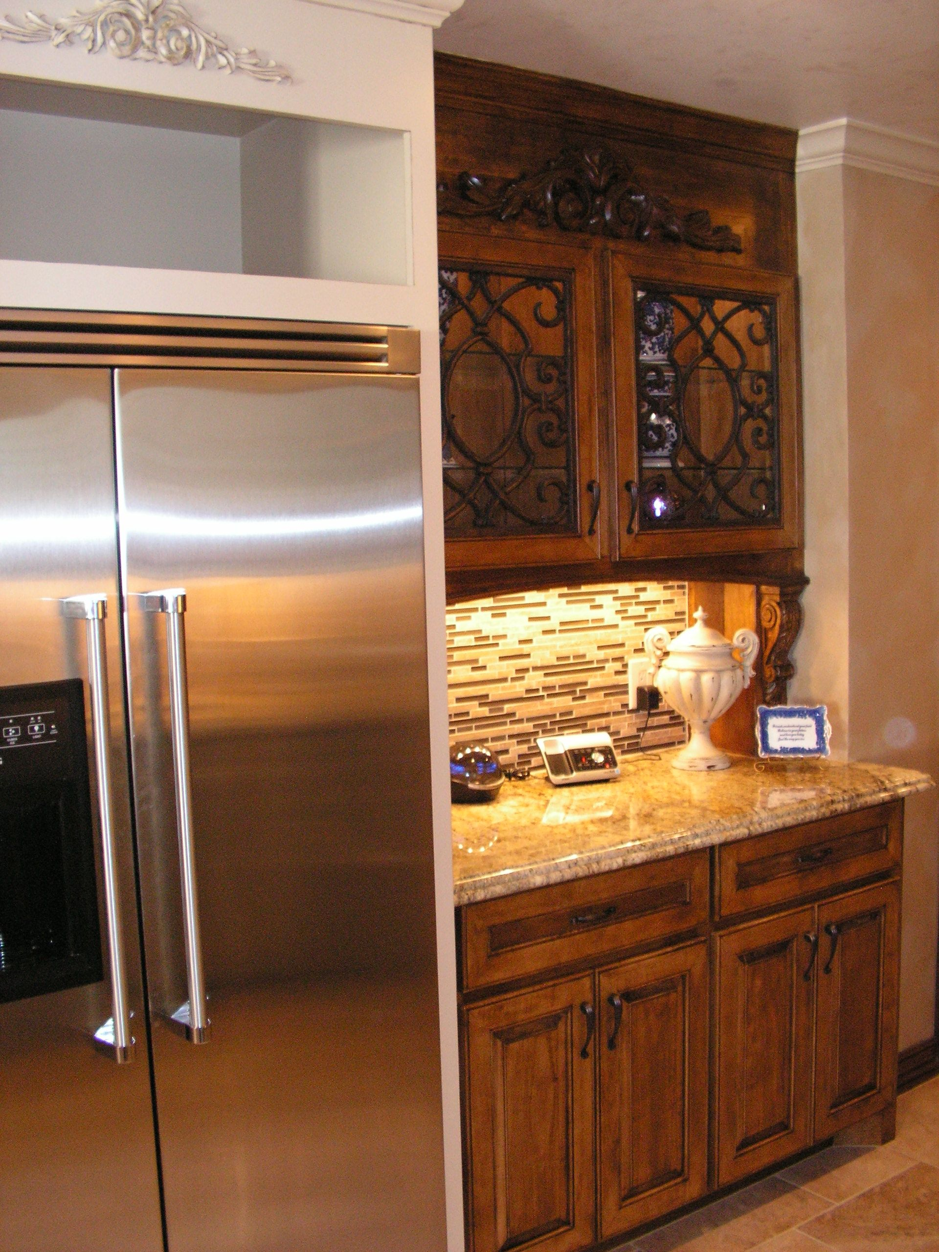 Custom stained cabinet with stacked glass and travertine ...