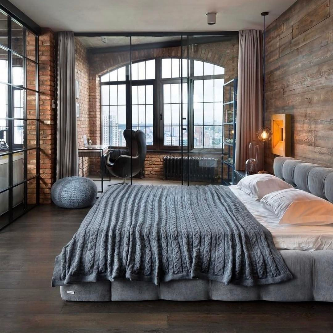 Exposed brick bedroom with private glasses in workspace  Rustic