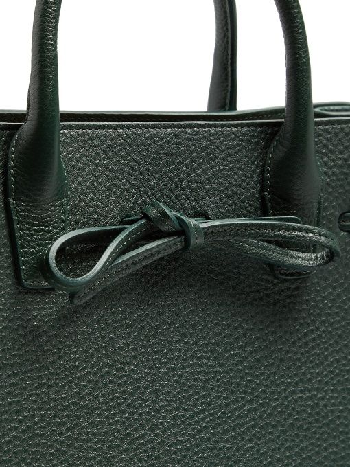Mansur Gavriel's Sun tote is lovingly crafted in Italy from supple yet hard-wearing grained leather in a rich bottle-green hue. It's decorated with a feminine bow, and can be carried by either the optional shoulder strap or the two top handles. It has more than enough room for your daily essentials, with three internal compartments and a single pocket.