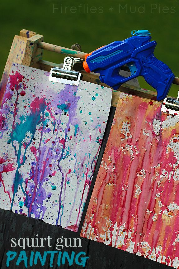 Squirt Gun Painting will keep the kiddos busy on a hot summer afternoon! - Fireflies and Mud Pies