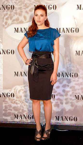 Satin teal blouse and high waisted skirt. Very elegant.
