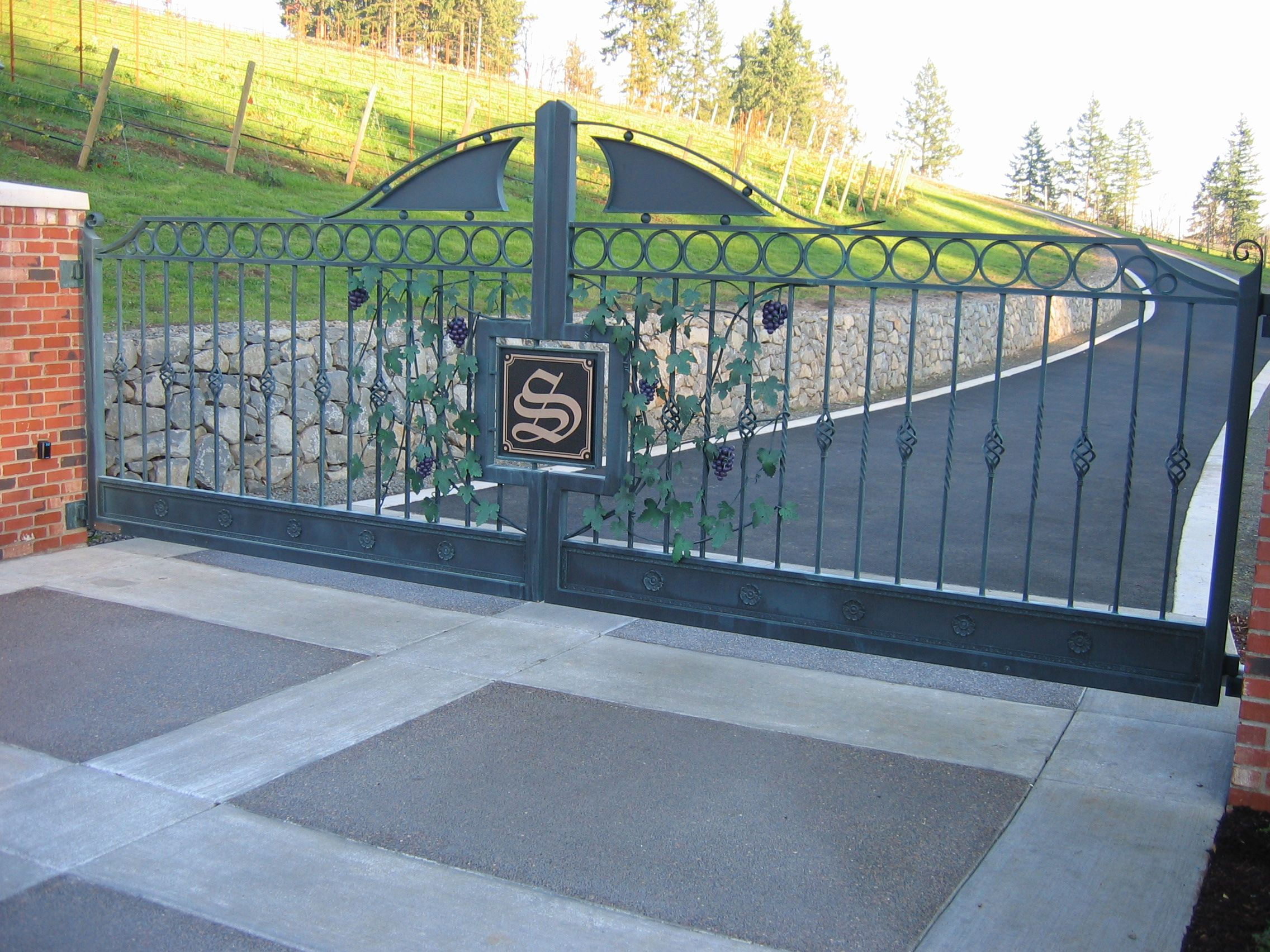 Driveway gate with custom ornamental pieces by Stratford Gate