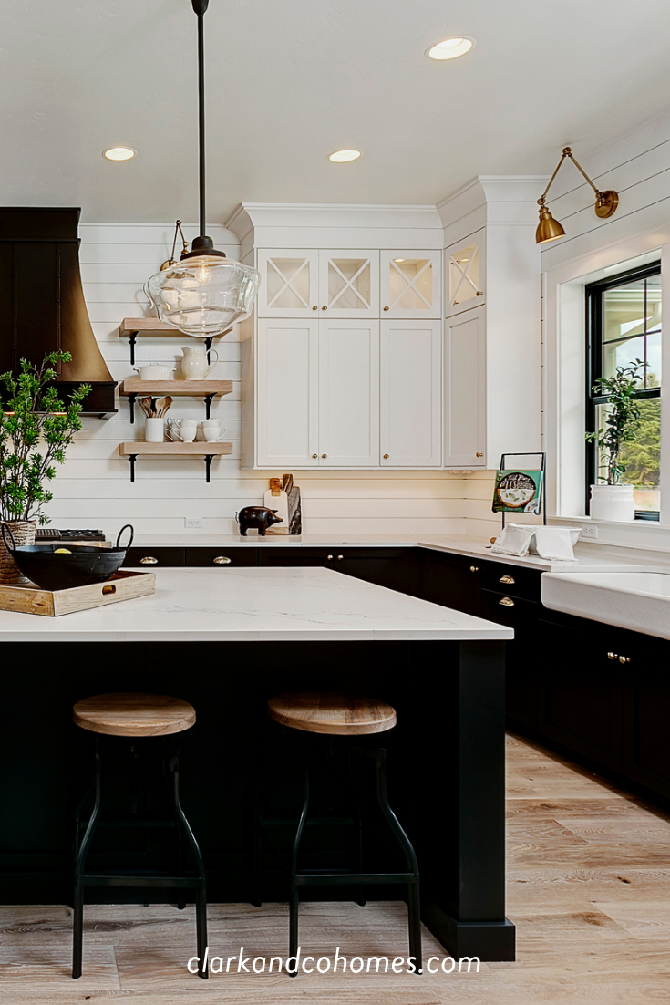 Black and white tuxedo cabinets are customized to this spacious Modern Farmhouse...