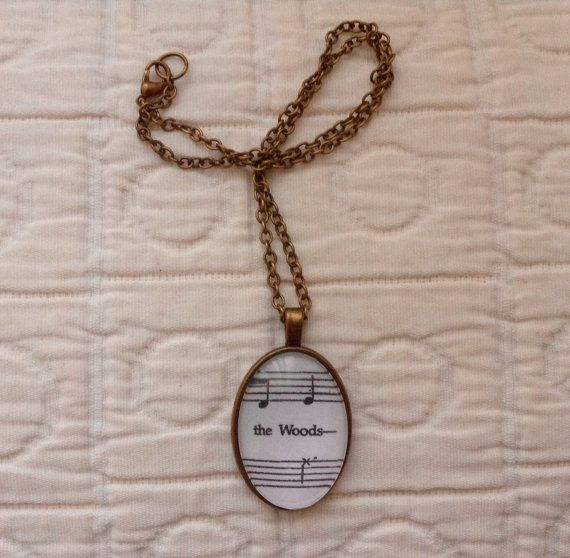 Necklace with sheet music from Into the Woods opening song. (other musicals and songs are available upon request, please feel free to message me about it!)