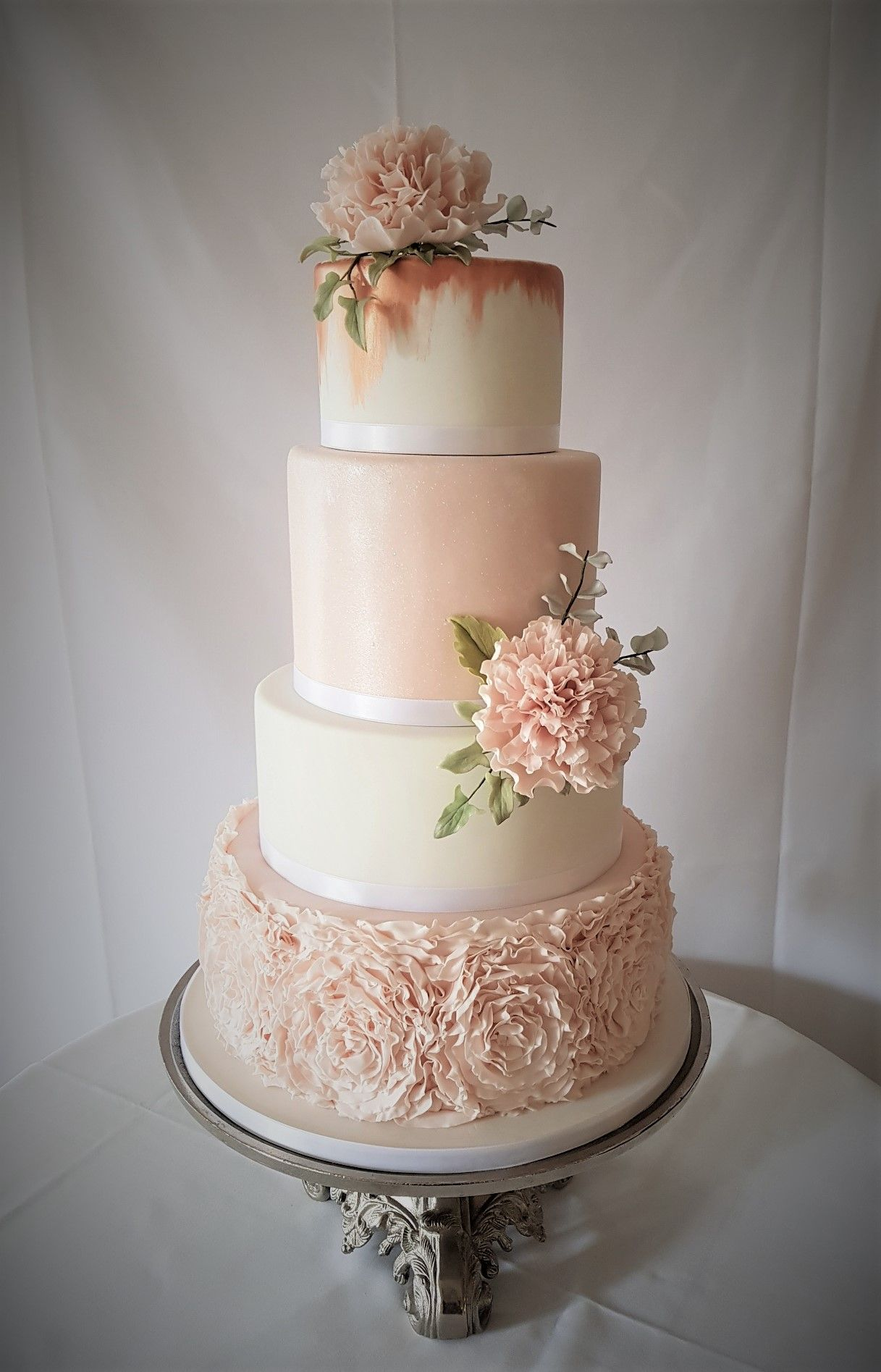 dusty pink and rose gold wedding cake pink peonies bindweed and eucalyptus foliage 13794