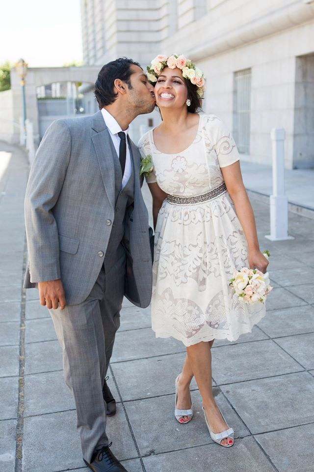 308ce5b999b Wedding kiss. Large flower crown. Gray three piece suit. SF city hall. Love.  Peonies. Ivory lace dress. Silver shoes.