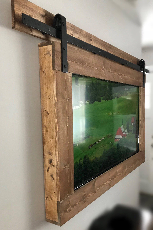 Custom wooden tv frame with modern barndoor style