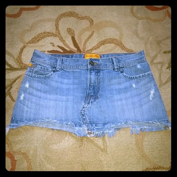 Hollister Denim Mini Skirt Distressed. Frayed bottom. About 11 inches long Hollister Skirts Mini