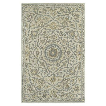 Add a pop of pattern to your living room or den with this hand-tufted wool rug, showcasing a medallion motif for stylish appeal.  Pr...