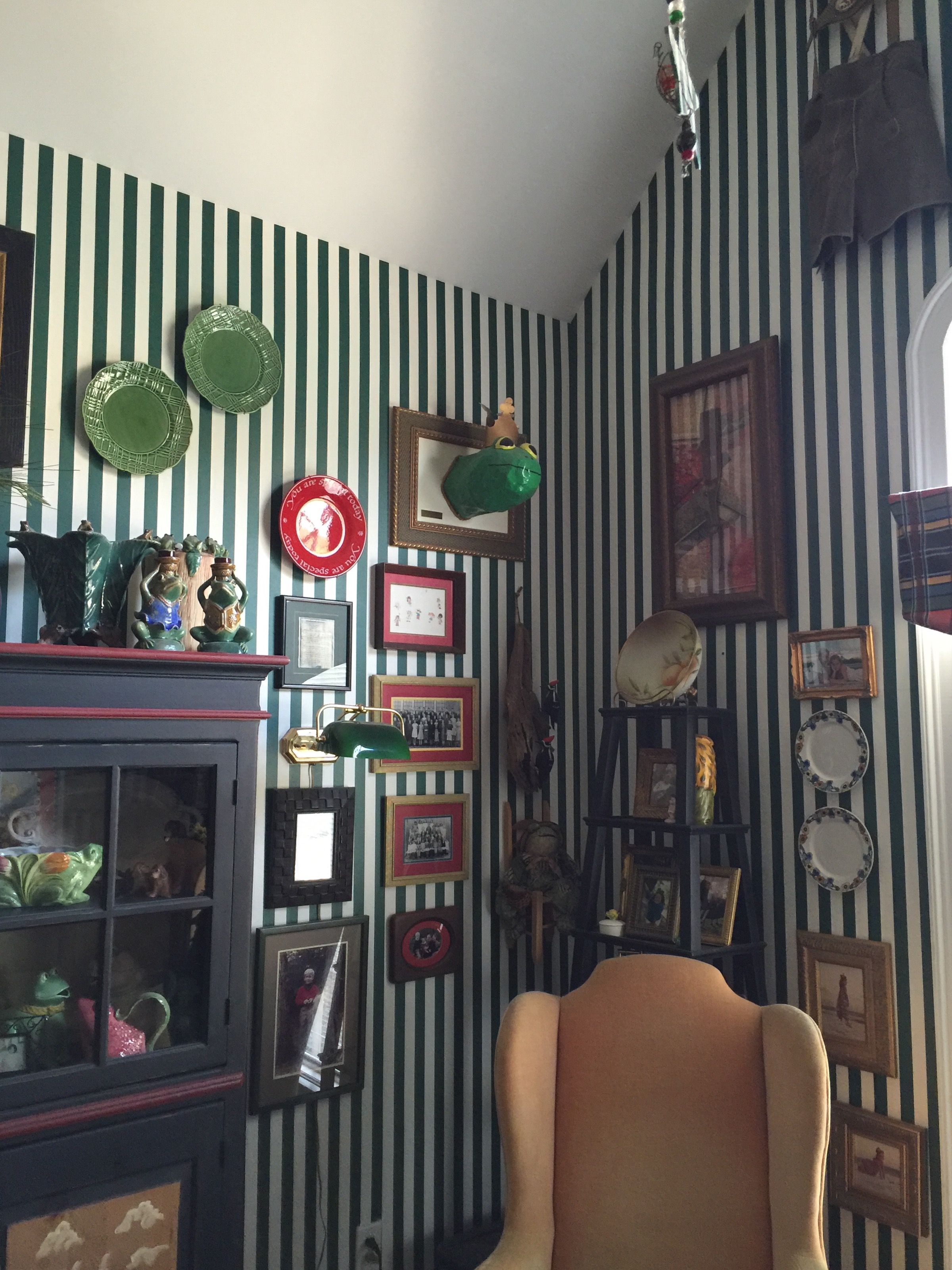Green and white striped wallpaper in the study with