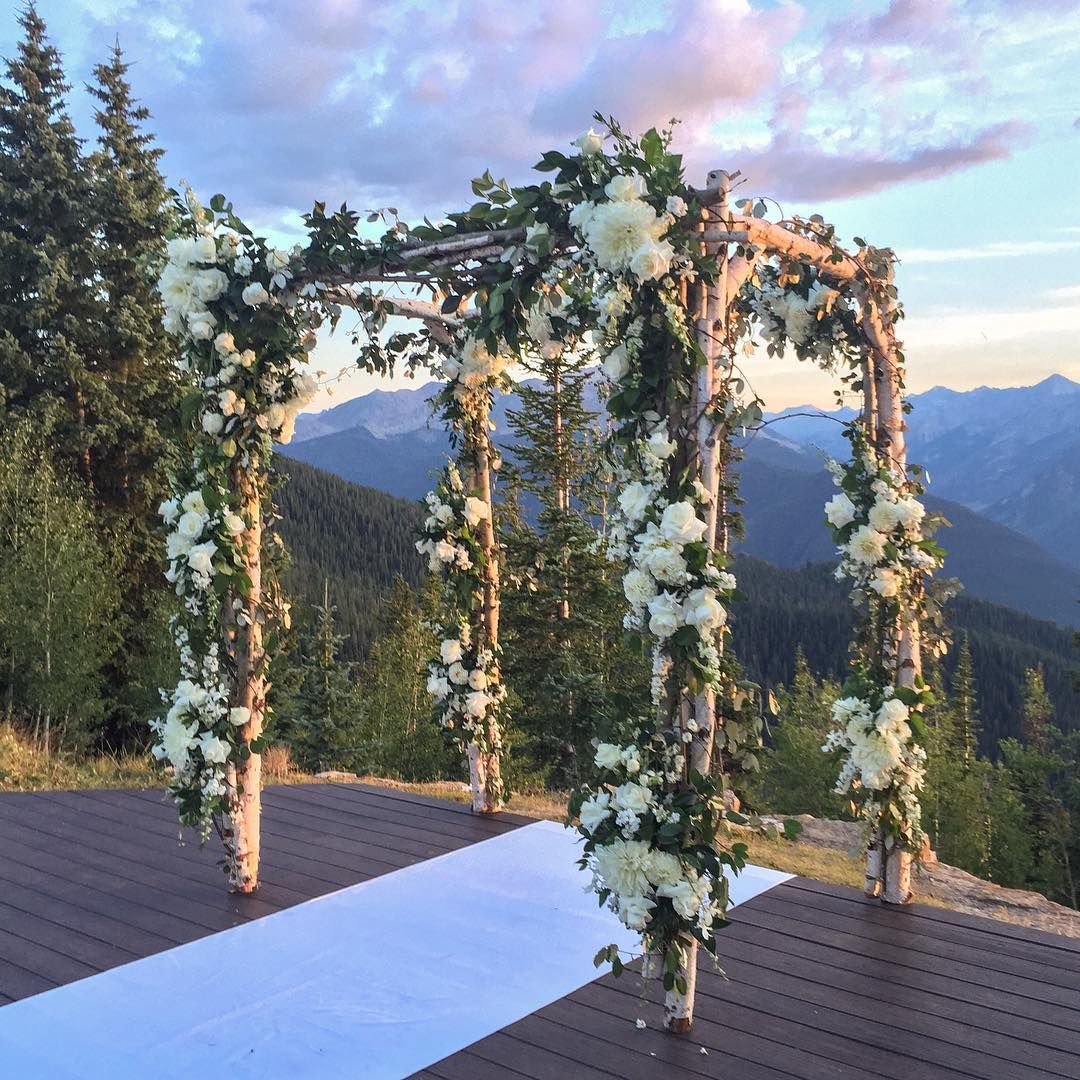 Gorgeous outdoor wedding ceremony arch at The Little Nell in Aspen, Colorado #mountainwedding #outdoorwedding