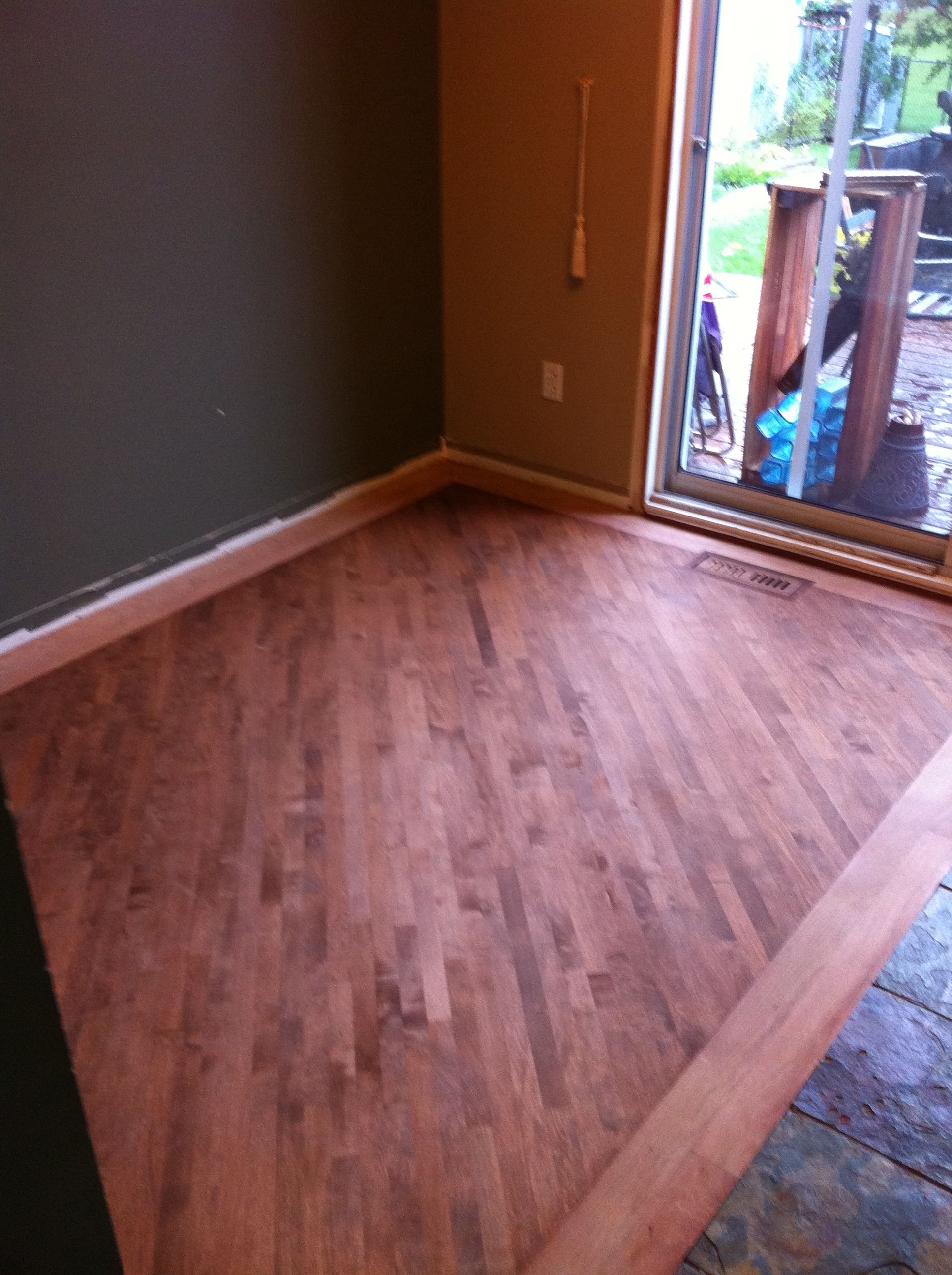 Stained maple floor with boarder work before first coat