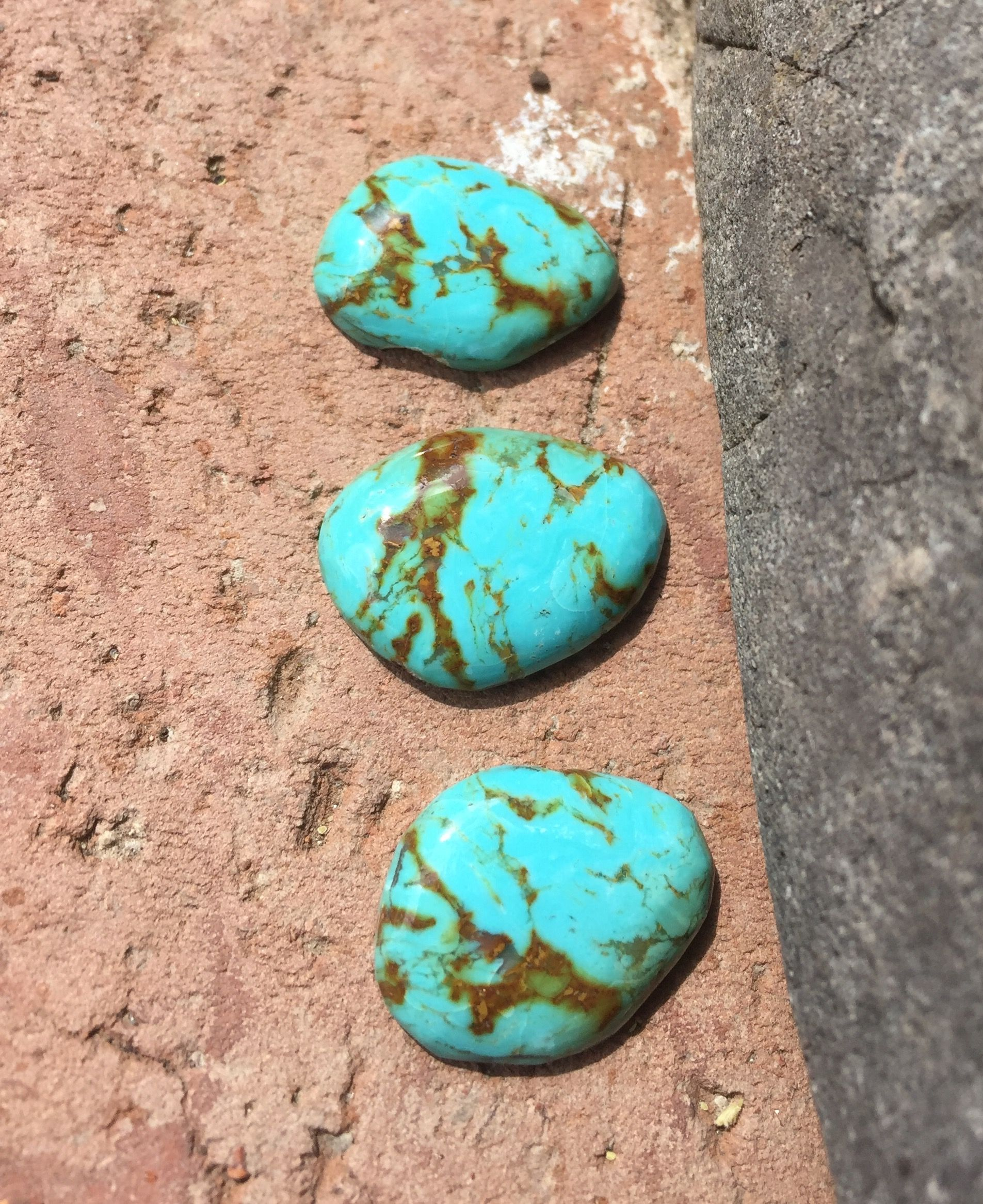 Natural sunlight on fresh Turquoise cabs. Estate sale find, in guessing Carico Lake or Royston.