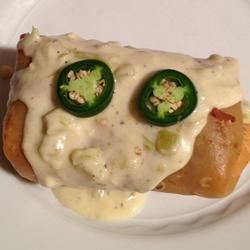Chicken Chimichangas With Sour Cream Sauce Recipe Sour Cream Sauce Mexican Food Recipes Food