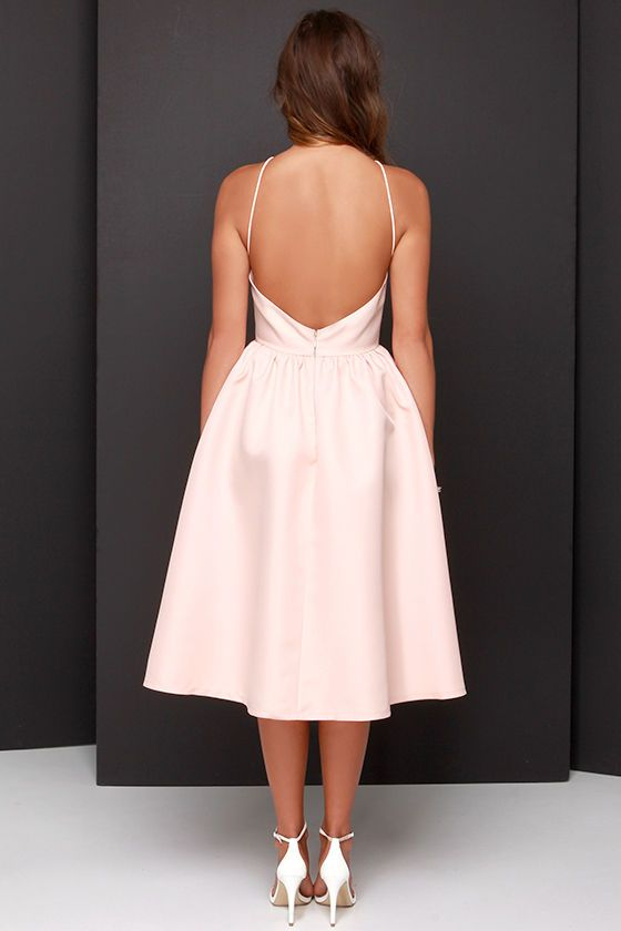 Lulus Exclusive! We're giving you the go-ahead to fill your world with grace and wonder in the Lead a Charmed Life Peach Midi Dress! Thick, woven peach fabric composes a flattering fitted bodice with a backless cut, and spaghetti straps sprouting from a squared-off neckline. Full midi skirt gathers into the waistline. Hidden back zipper/hook clasp. Fully lined. 100% Polyester. Hand Wash Cold.