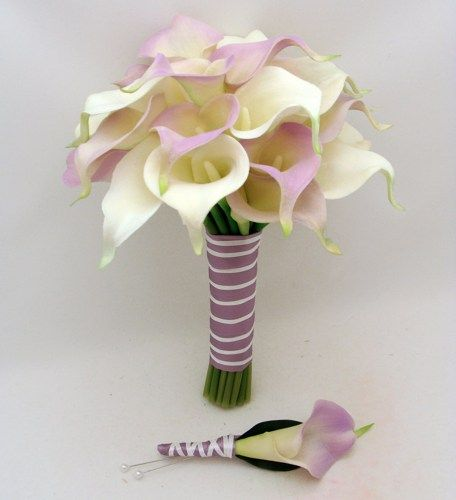 White and light touch of purple calla light....can change to any color using flower spray