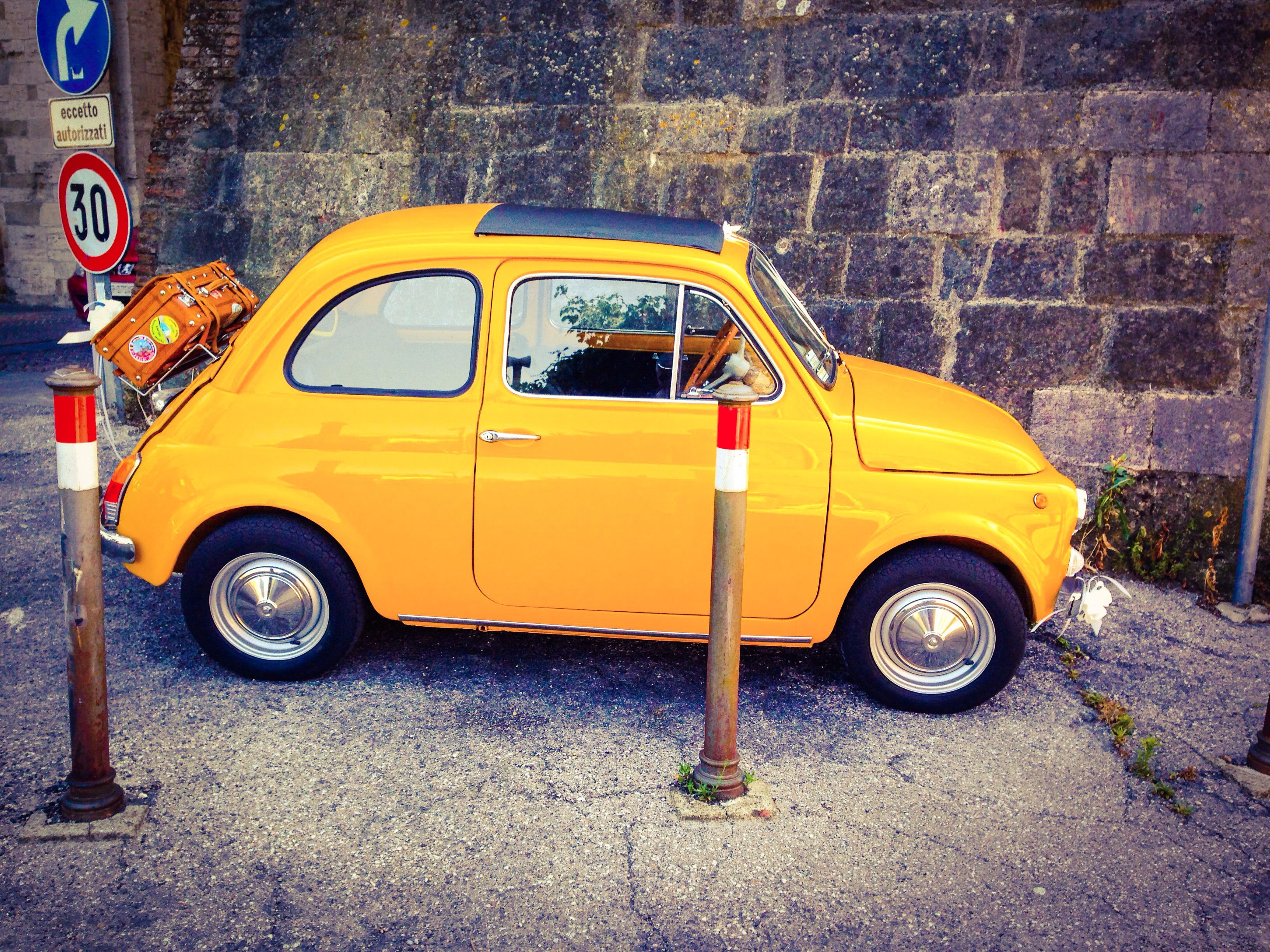 Adorable yellow Fiat 500... pretty sure this is my dream car :)