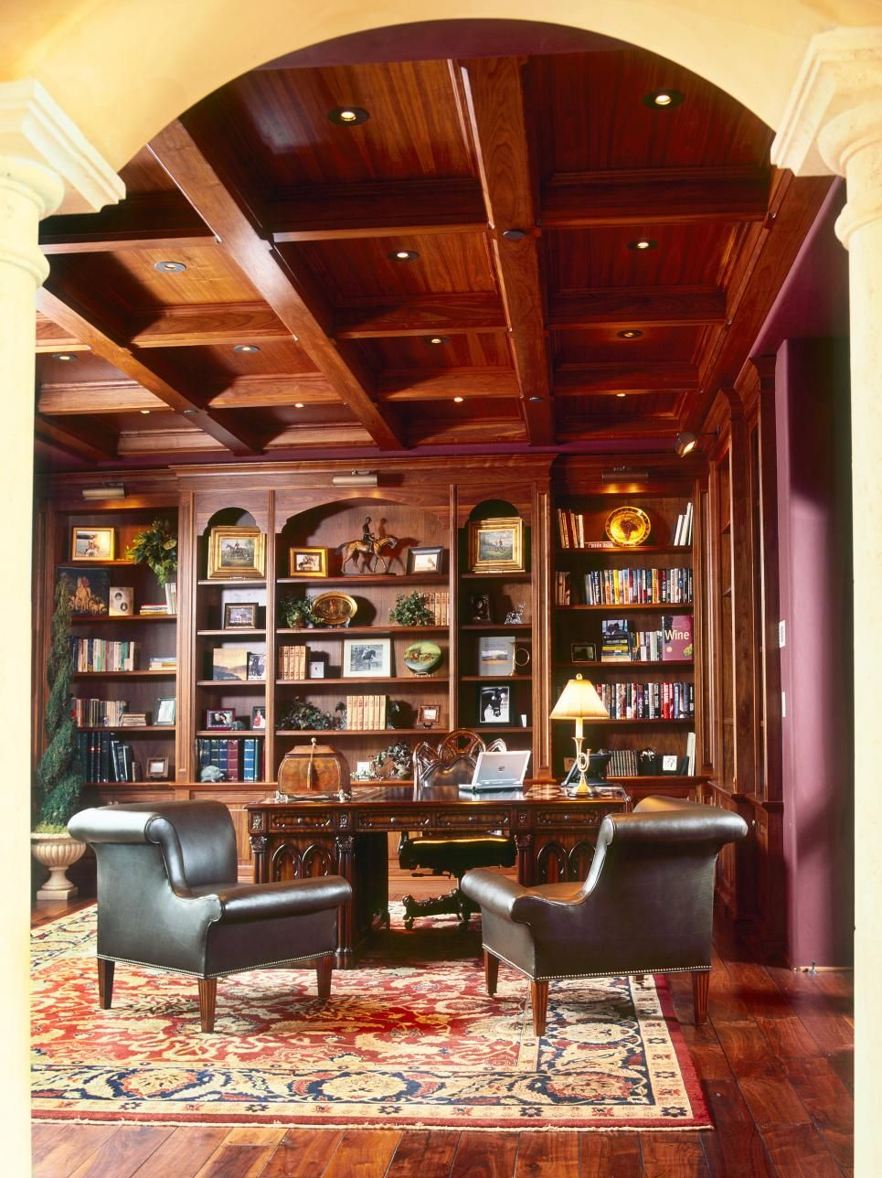 The high coffered ceiling and arched entryway bring sophistication