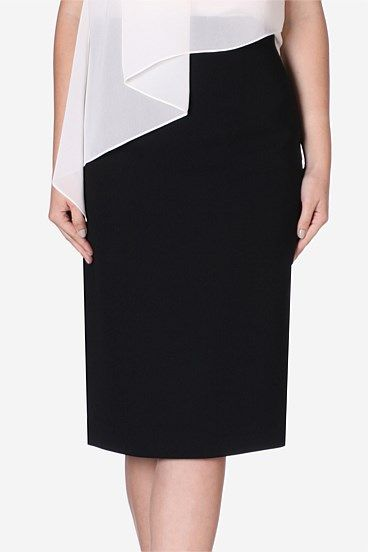Raven Crepe Forties Pencil Skirt. A must have for any smart wardrobe is this season's high waisted black crepe skirt. Elongating the silhouette with a high waist and slim fit, this is the perfect work to play number.