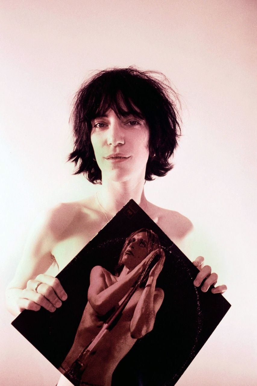 A then relatively unknown Patti Smith holds The Stooges' Raw Power as she poses for Michael Ochs in Los Angeles, CA., November 1974.