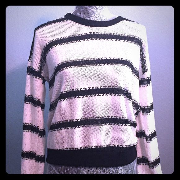 Striped knit sweater Adorable black & cream knit sweater. Worn gently only once. Looks great with your favorite pair of jeans! Moon Collection Sweaters