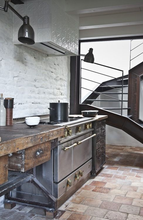 Rustic modern kitchen -- whitewashed brick, terracotta tile floors, minimal