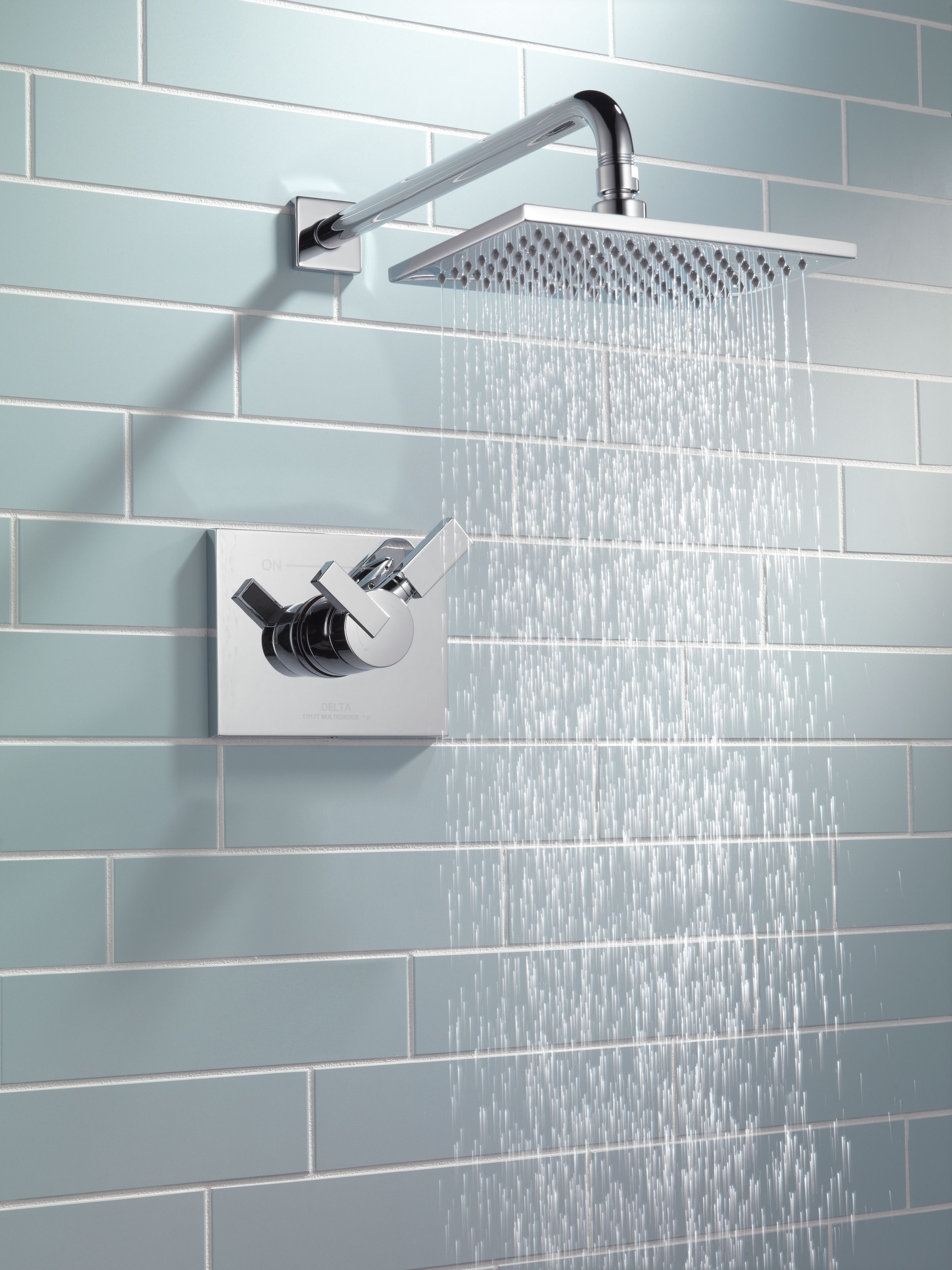 Delta Faucet Vero rain shower with cool blue subway tile make for a ...