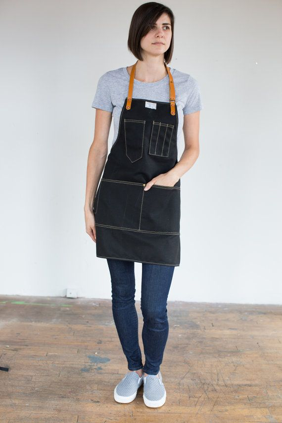 ed2c4ed28c2 A traditional unisex work apron with adjustable leather neck and waist  strap. Sizing (Measure over clothing) XS: Waist 24-28 / Hip 32-35 • Apron  26.5L x ...