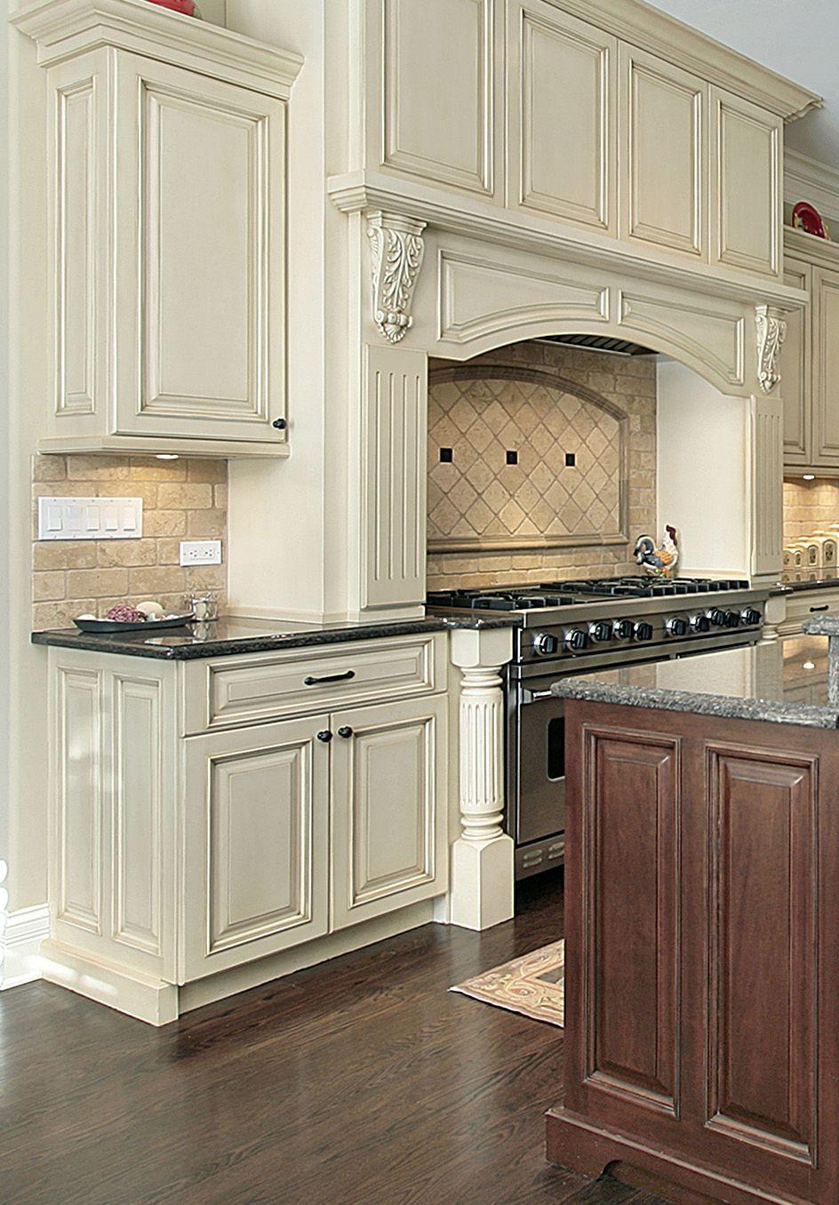Prasada antique white kitchen with large decorative range hood walnut island design ideas