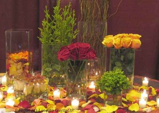 red and yellow wedding cake and centerpieces reception ideas