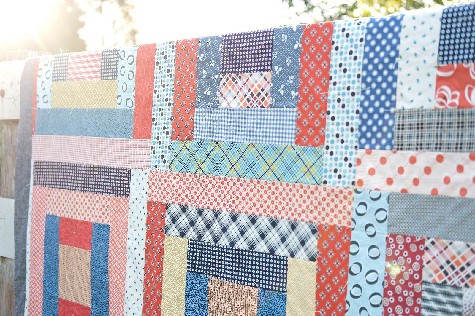 May Giant Block Picnic Quilt (with picnic quilt tips) is part of Picnic quilt, Barn quilts for sale, Big block quilts, Table quilts, Quilts, Easy quilts - Binding Essex Linen in Black Fabrics Various Denyse Schmidt Batting Queen size flannel flat sheet (I got mine on eBay!)